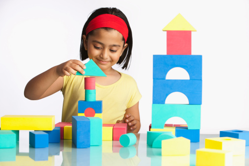 Girl (6-7) playing with building blocks